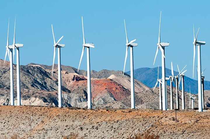 Photo of wind turbines at a mining site.
